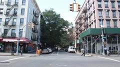 Avenue A Across from Tomkins Square Park Looking down 10th Street Stock Footage