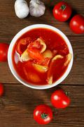 Still life with tomatoes and onion sauce Stock Photos