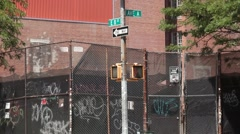 A Fence and Graffiti on Avenue B in the East Village Stock Footage