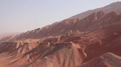 Flaming Mountains in desert, China Stock Footage