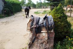 Old ornamental saddle on the stone outdoor - stock photo