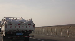 Driving on Chinese highway, trucks Stock Footage