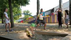 Stock Video Footage of Children playing game with passing under rope and little kid playing in sand, 4k
