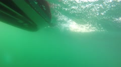 Underwater shot of small raft boat on rough ocean Stock Footage