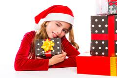 Christmas Santa kid girl happy excited with ribbon gifts - stock photo