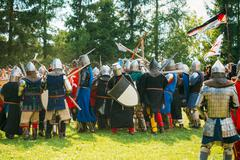 Historical restoration of knightly fights on festival of medieva - stock photo