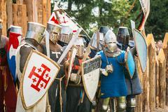 Historical restoration of knightly fights on festival of medieva - stock photo