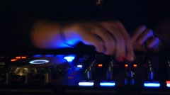 DJ Mixing Music on Console at Night Club Stock Footage