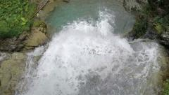 View from above of running and falling fresh water into waterfall - stock footage