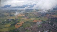 Take off from cloudy Edinburgh Scotland Stock Footage