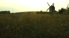 windmill at sunset - stock footage