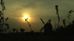 windmill at sunset - stock footage