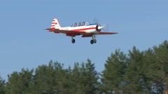 Yak-52 landing on field Stock Footage
