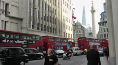 London Buses & Black Cab near Monument & The Shard Stock Footage