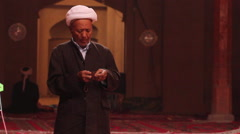 Uyghur muslim in Emin Mosque, Turfan, China Stock Footage