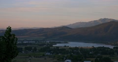 Mountain lake and town pan - stock footage