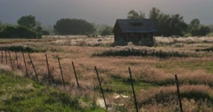 Old cabin and fence mid shot - stock footage