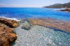 Stock Photo of Denia Alicante Las rotas rocky beach in Spain