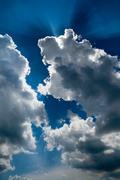 Sun rays through the clouds Stock Photos