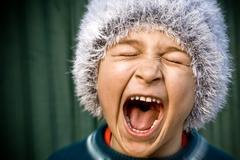 Crazy kid screaming loudly Stock Photos