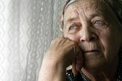 Sad lonely pensive old senior woman Stock Photos