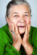 Happy and amazed old senior woman - stock photo