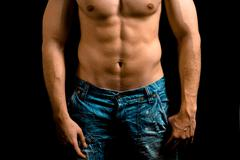 Torso of muscular man with nice abdomen - stock photo