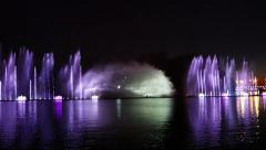 Musical dancing fountain, light visual effect, city night illumination Stock Footage
