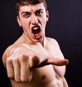 Scream of furious angry violent man Stock Photos