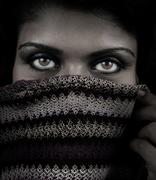 Close up portrait of woman with mystery eyes - stock photo