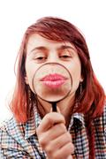 Kiss of funny woman and magnifying glass - stock photo