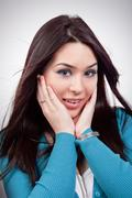 Amazed expression on young woman face Stock Photos
