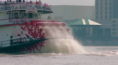 Big wheel of riverboat on Mississippi River, sunny day, Slo mo, New Orleans, LA Stock Footage