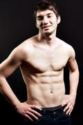 Shirtless sexy man with muscular abdomen - stock photo