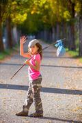 Little kid with hobo stick bag and bundle girl saying goodbye Stock Photos