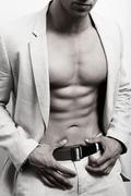 Muscular man with sexy abs and suit Stock Photos