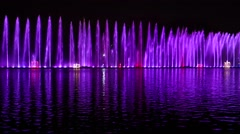 Musical dancing fountain, water visual effect, city night illumination Stock Footage