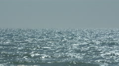 Vast sea with sun reflections Stock Footage
