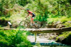 Mountain Bike cyclist riding track at sunny day, healthy lifesty Stock Photos