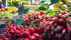 Fresh vegetable shop - stall of radishes in a market vertical panoramic shot Stock Footage