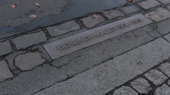 Marker for What used to be Berlin Wall in Berlin Germany - stock footage
