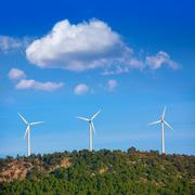 Aerogenerator windmills in the mountain top - stock photo