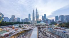 Day to night cloudy sunset at Kuala Lumpur City Centre Stock Footage