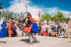 Knights In Fight With Sword. Restoration Of Knightly Battle - stock photo
