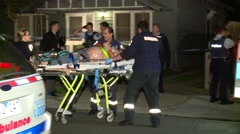 Bloodied man on stretcher Stock Footage