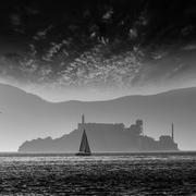 Alcatraz island penitentiary at sunset backlight in san Francisc Stock Photos