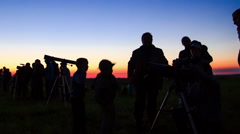 Astronomers looking through a telescope Stock Footage