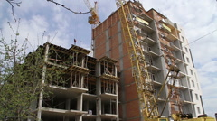 Construction. Building. Crane. Focus pull. Stock Footage