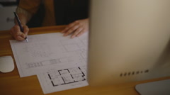 Young Female Architect Studying Plans In Office on blueprint Stock Footage
