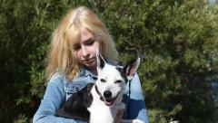 Girl Holding a Small Dog Stock Footage